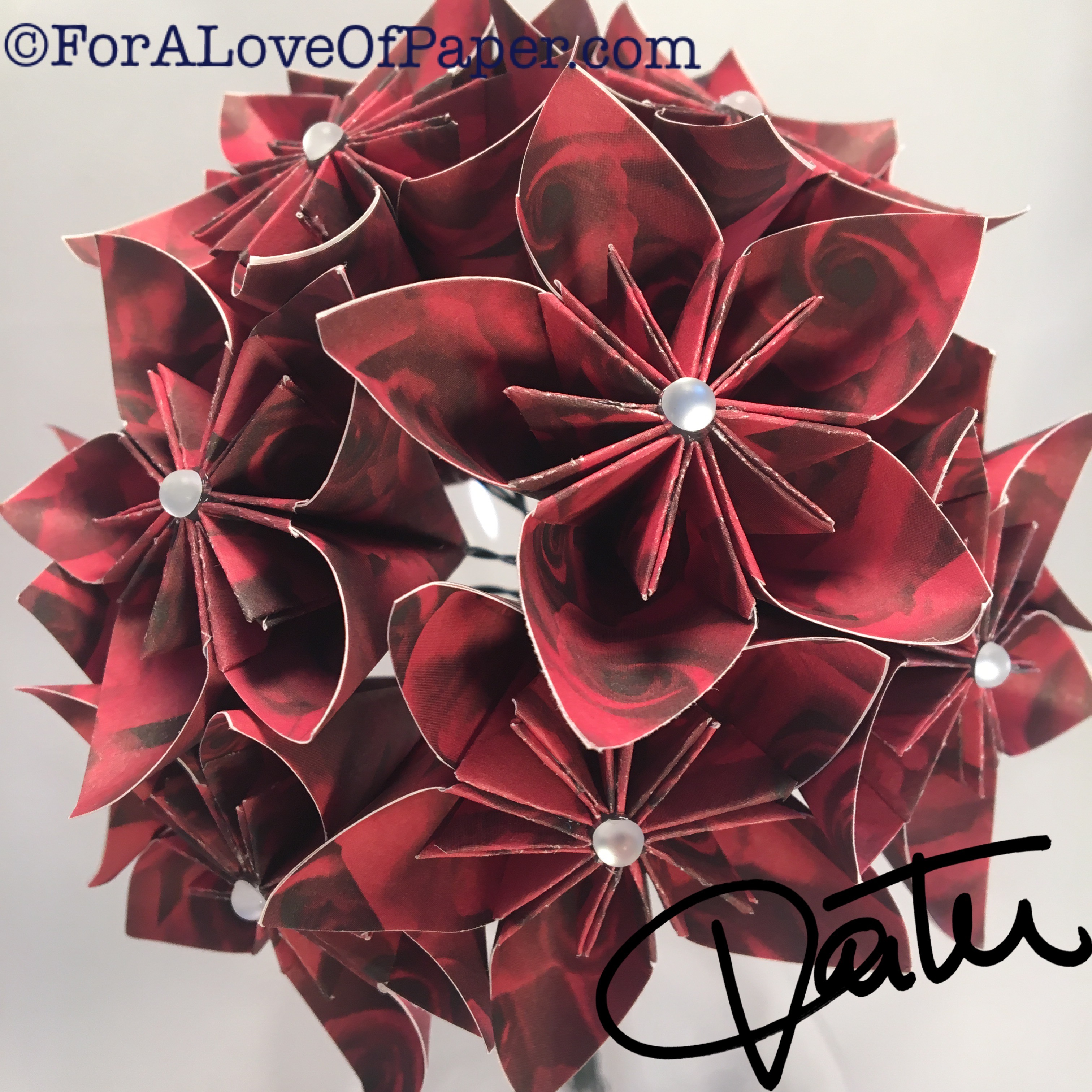 Paper flowers made of red rose scrapbook paper