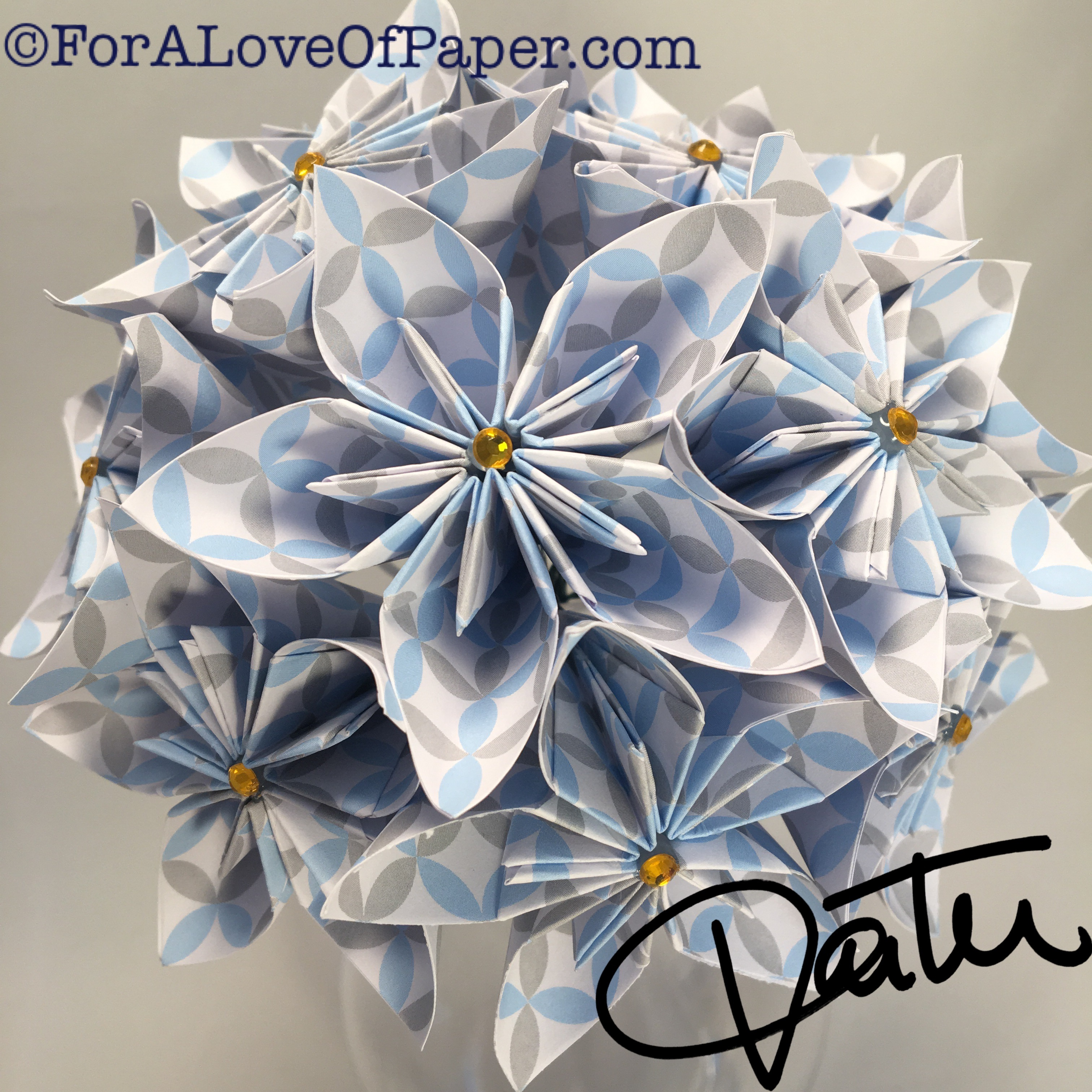 White paper flowers with blue and grey pattern