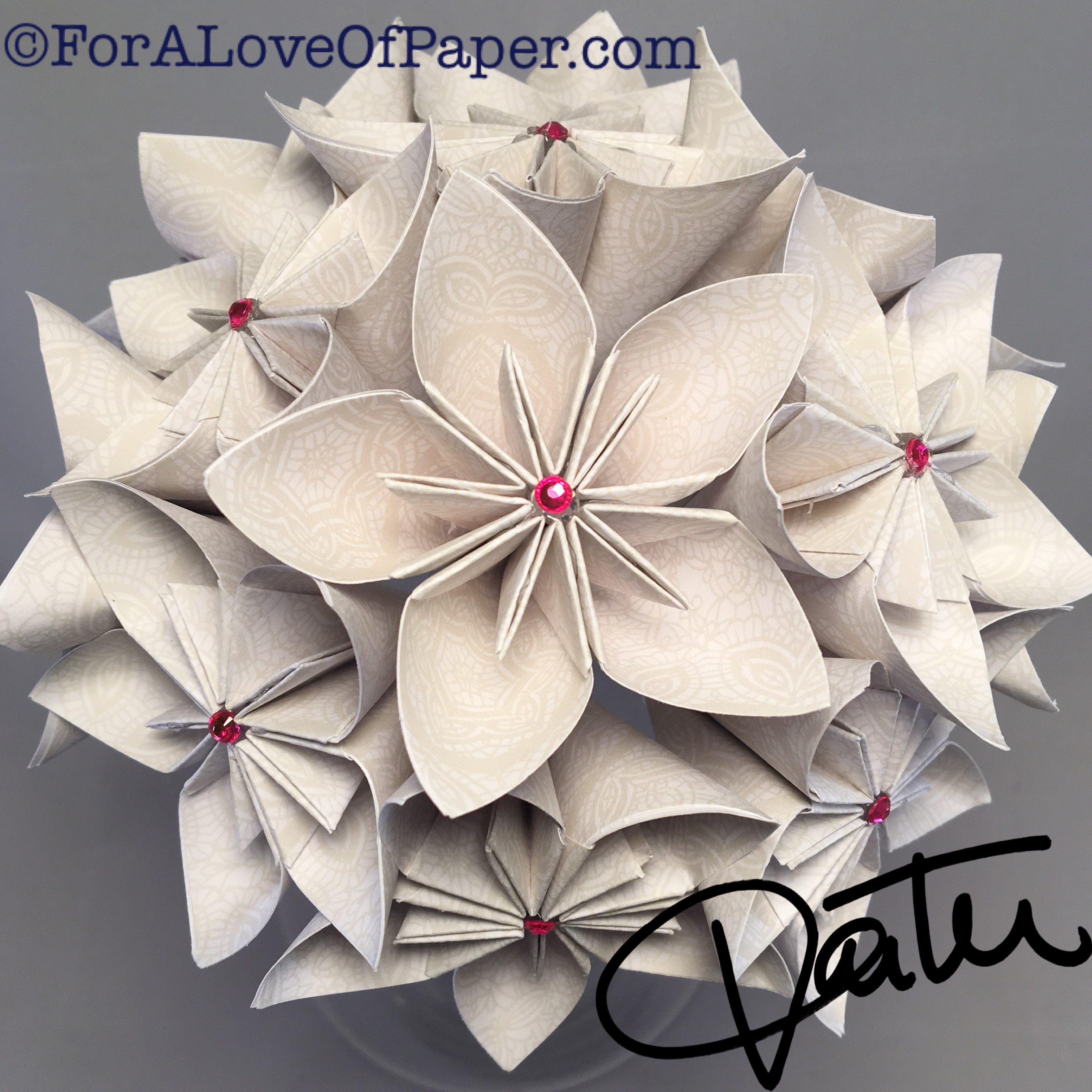 Paper flower bouquet made from cream colored paper with white pattern