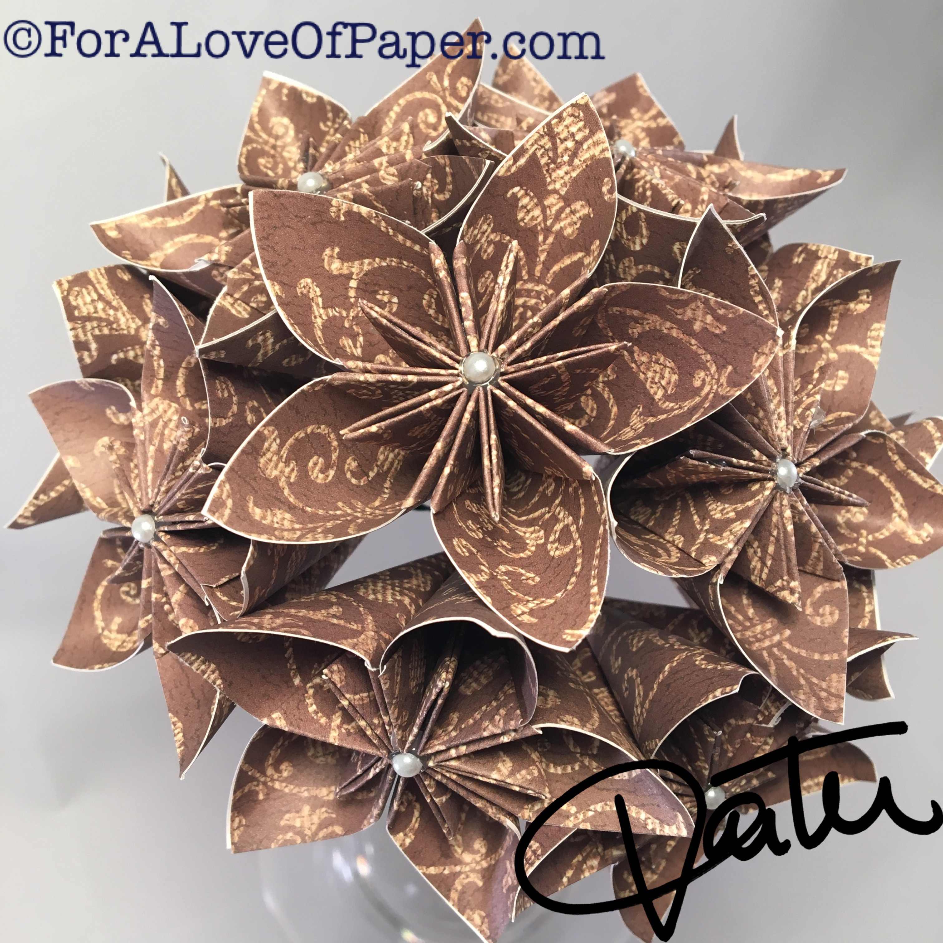 Paper flower bouquet made from mocha colored paper with decorative pattern