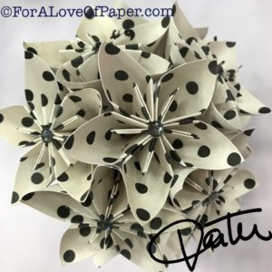 Paper flowers in classic dot themed scrapbook paper