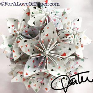 Paper flowers in colorful tiny heart themed scrapbook paper