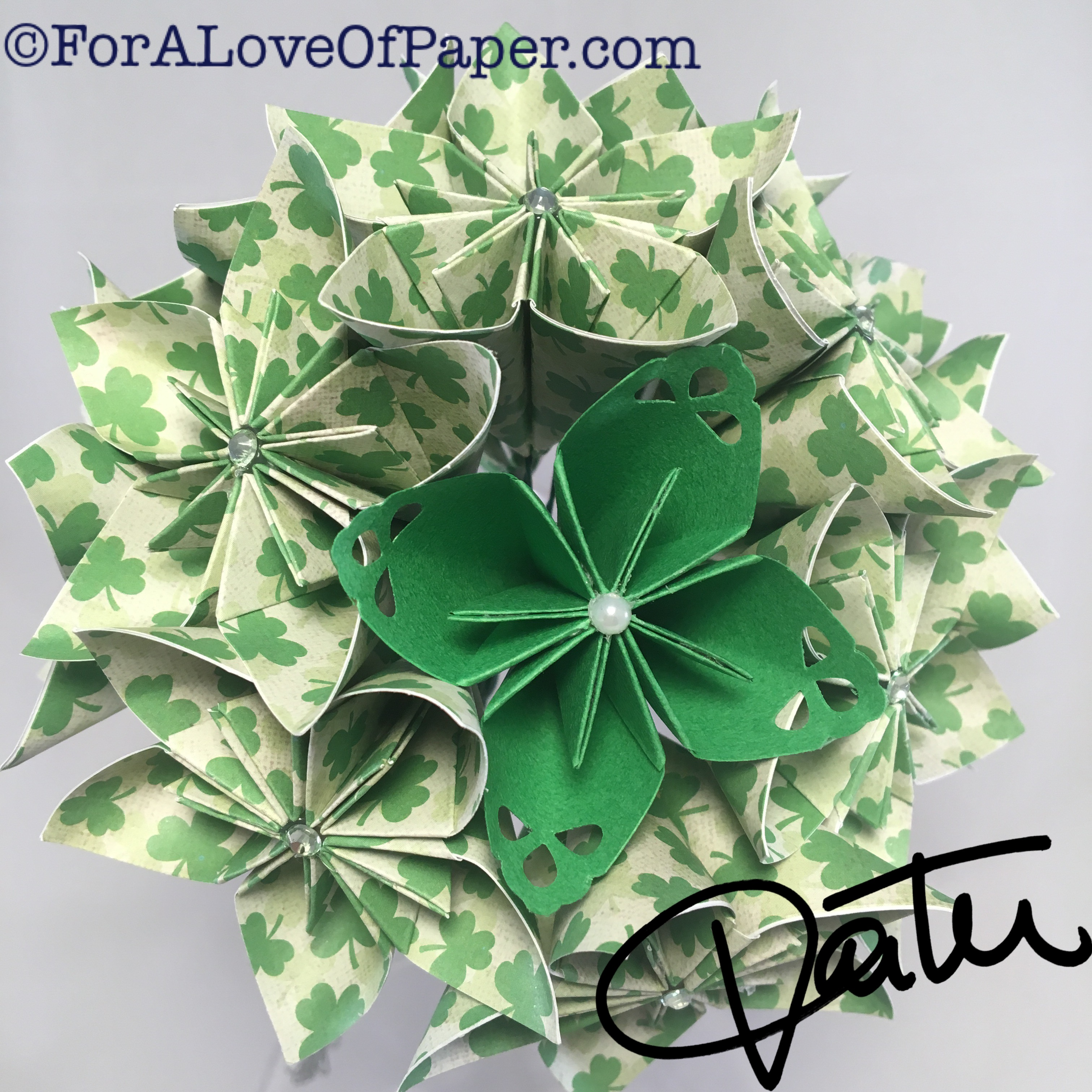 Paper flowers in green clover themed scrapbook paper