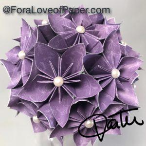 Paper flowers in purple dandelion themed scrapbook paper