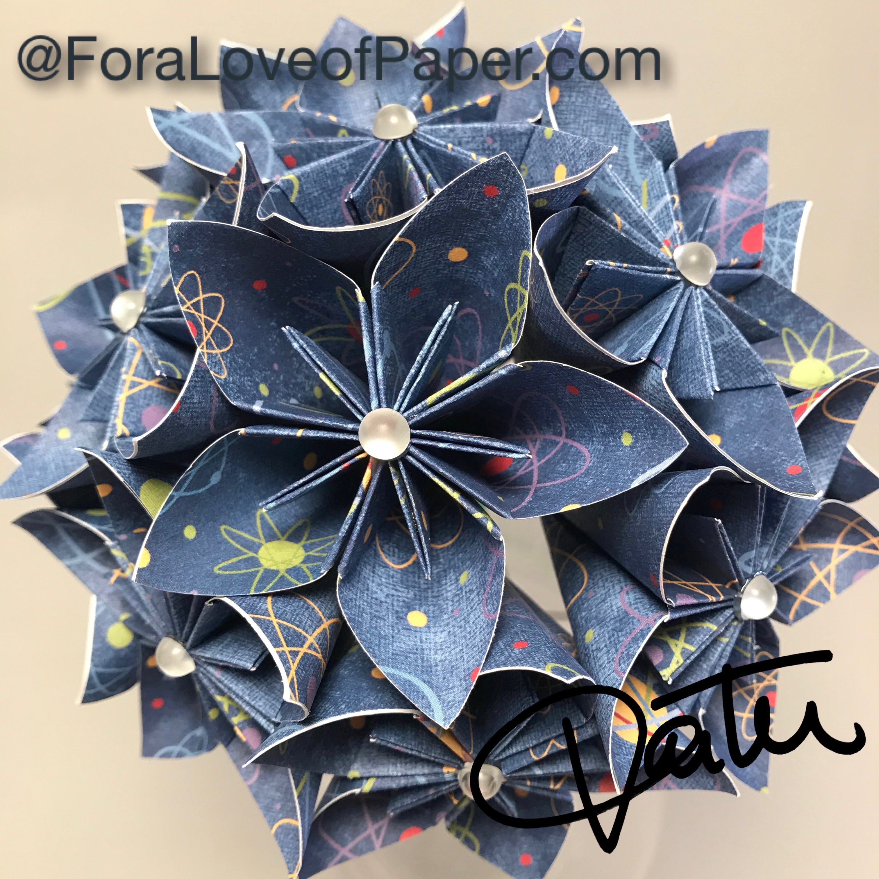 Paper flowers in science themed scrapbook paper