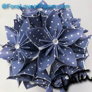 Paper flowers in tiny stars themed scrapbook paper
